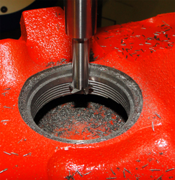 Threadmilling of Freeze Plug hole.